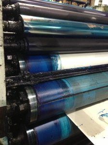 "The ""C"" in CMYK, these cyan ink rolls won't stay still for long as the plant gears up to print another product."