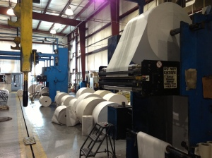 Different projects require different types of paper and due to a shuttle system set in the floor, press operators can easily transition between rolls.