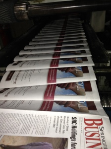 Hot off the press: Once the ink plates are aligned, hundreds of copies of the journal roll off the press each minute.