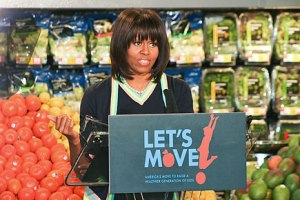 First lady Michelle Obama addresses a crowd of about 100 at the Walmart Neighborhood Market on South Glenstone.