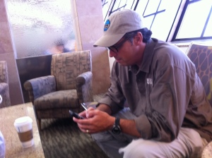 Mobile Office: Rick Zorehkey of Convoy of Hope conducts business during a layover in Dallas.