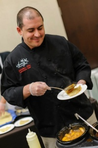 John Allen, head chef at the Aviary Cafe, is a 2005 graduate.