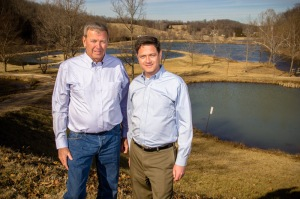 "David and Larry pose near man-made lakes on Paul Mueller's ""country"" home."