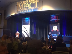 The Ramada Plaza Hotel and Oasis Convention Center stage looked beautiful as Publisher Jennifer Jackson welcomed those in attendance.