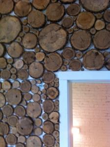 The inside of his door is framed in log ends.